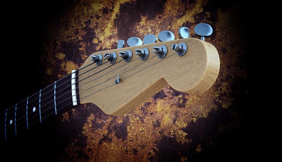 Masoni Maroquinerie, créateur sangle de guitare custom pour le guitariste Rock